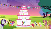 Rainbow spinning around the cake to blow all the candles S4E12