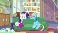 Rarity and Rainbow scowling at each other S8E17