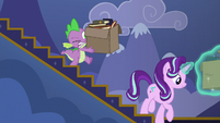 Spike carrying a heavy box of books S6E25