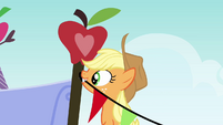 Applejack tying a rope on a nail S3E08