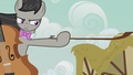 Octavia holding out her cello bow S5E9.png