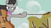 Octavia holding out her cello bow S5E9