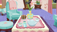 Tea set and party snacks appear on table S7E12