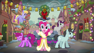 The Spirit of Hearth's Warming Presents standing in front of the town's water fountain S06E08