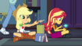 Applejack stacks books; Sunset plays video games EGDS6.png