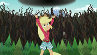 Applejack tosses the large boulder into the air EG4