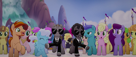 Bodyguards make a path through the crowd MLPTM