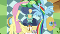 Fluttershy and Rainbow fly in a circle over Zephyr S6E11.png