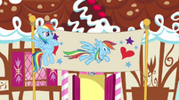 Rainbow Dash beside birthday banner S4E12
