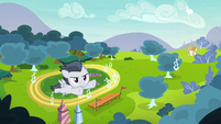 Rumble flying high above the racetrack S7E21