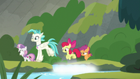 Terramar and CMC jumping over a stream S8E6