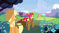 Applejack and Apple Bloom look at Pinkie zooming off S3E3
