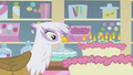 Gilda looking at relit candles S1E05.png