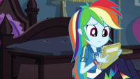 Rainbow Dash holding Twilight's notebook EGDS6