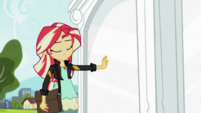 Sunset Shimmer places a hand on the portal EGS3