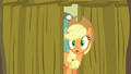 Applejack peeking behind the backstage curtain S6E20.png
