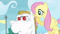 Fluttershy whispering at Bulk's ear S4E10