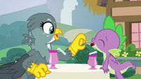 Gabby feeding a cherry to Spike S9E19