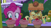 Pinkie Pie eyeing a pink cupcake S9E17
