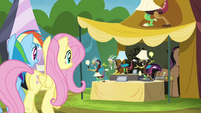 Rainbow and Fluttershy approaching Stellar Eclipse's stall S4E22