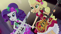 Rarity and Applejack singing hand-in-hand EG4