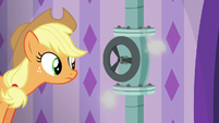 Applejack looking at leaky pipe S6E10