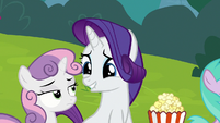 Rarity looking excitedly at Sweetie Belle S7E6