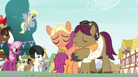 Snap and Mane still hugging Scootaloo S9E12