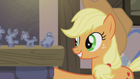 Applejack places her rock doll on the fireplace S5E20
