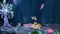 Element bearers and Pillars next to Tree of Harmony S7E26