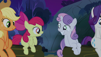 Sweetie Belle and Apple Bloom smiling at each other S3E06