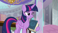 Twilight Sparkle holding the EEA's guidebook S8E1
