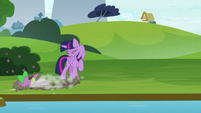 Twilight looks away as Spike crashes S8E24