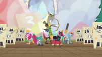 Discord and friends surrounded by skeleton puppets S6E17
