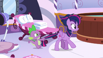 Spike holds Twilight by the tail S5E3