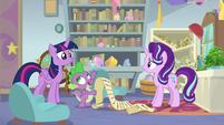 Spike starts to read Twilight's decree S9E20