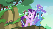 Starlight Glimmer pointing at a nearby cliff S7E17