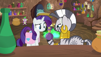 Zecora giving Rarity a bottle of cream S8E11