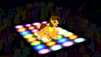 Cheese dancing on a floor with colored light S4E12