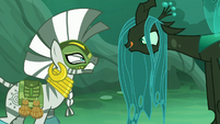 Chrysalis licks her mouth in front of an angry Zecora S5E26