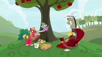 Big Mac giving a scroll to Spike S9E23