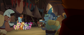 Capper watches creatures crowd around Mane Six MLPTM
