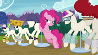 Pinkie Pie leaning on pony mannequin S4E18