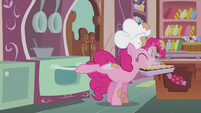 Pinkie closes oven while her cutie mark glows S5E8
