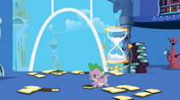 596px-Spike Picking Up Books