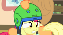 Apple Bloom being put on a second helmet S4E17