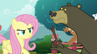 Fluttershy looking closely at Rarity's leaf wig S7E19