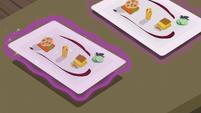 Row of fancy food trays S6E12