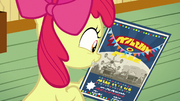 Apple Bloom looking at County Fair flyer S9E22