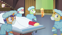 Applejack and surgeon ponies looking shocked S6E23